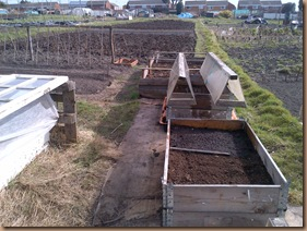 Top raised bed-Strawberries middle is Luttuce -bottom Spring Onions and raddish