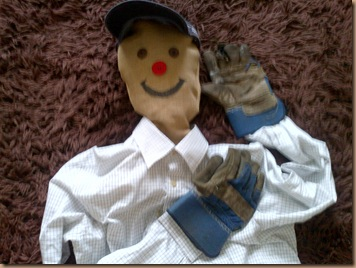 Scarecrow, his face is sewn in place as are his gloves