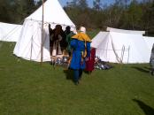 Armour and weaponry on show in various tents.