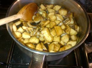 Apples, onions, simmering to make Apple and Blackberry Chutney
