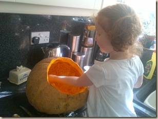 Scraping out the pumpkin