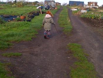 After a hard mornings Dig with bucket and spade. On the way home for lunch from allotments, Our Granddaughter