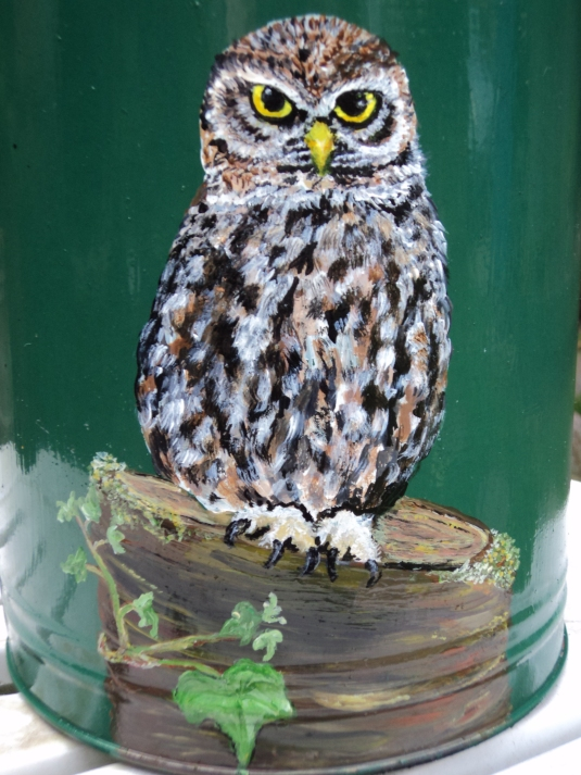 Close up of owl painting on churn