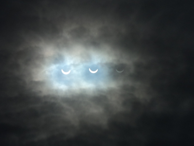 Here you get the strange effect of seeing the eclipse 3 times as my window reflected the sun back