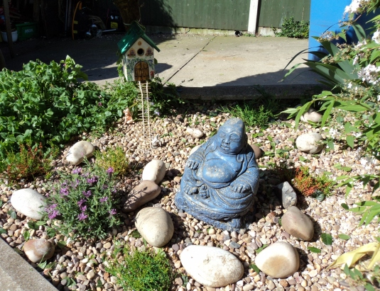 Fairy and Gnome have good company with Buddha to watch over them both.