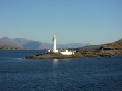 the Light house in a clearer view as we traveled still closer and past it. Look at the head land behind.. Wonderful..